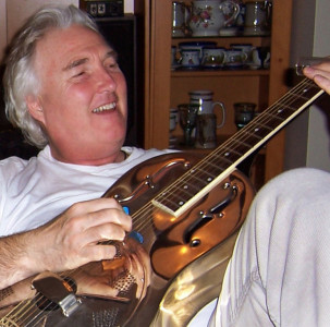 Derek Mason (1955 - 2015) - Derek relaxing with his resonator guitar, during Christmas 2011)