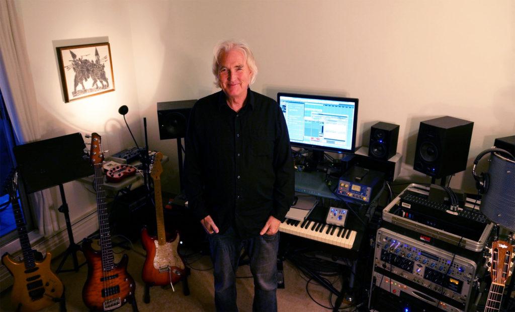 Photo - music producer Derek Mason smiling in his Beach Avenue studio December 11, 2014